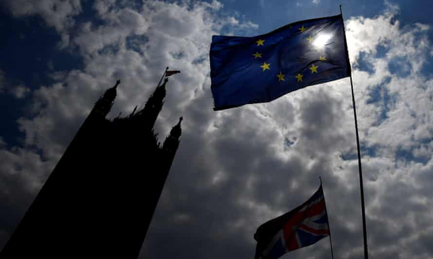 An EU flag and a union jack flying near the Houses of Parliament