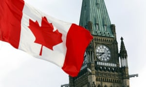 The Canadian flag flies on Parliament Hill in Ottawa. Canada's electronic spy agency has shared information about Canadians with foreign partners.
