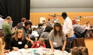 Activities in full flow in Hall 2 at the Guardian cartoon and art family day.