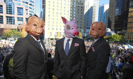 protesters dressed in suits with pig masks on