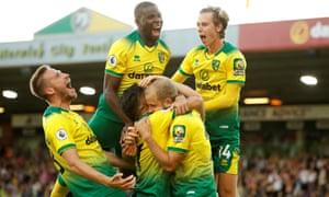 Norwich City's Teemu Pukki celebrates with teammates after scoring their third goal.
