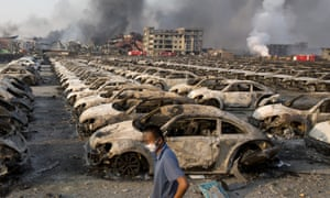 The charred remains of new cars at a warehouse in China's north-eastern port at Tianjin.