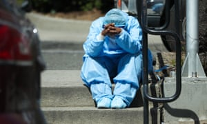 A sad and tired healthcare worker is seen by the Brooklyn hospital center in New York on 1 April 2020, when the state was the worldwide center of the pandemic.
