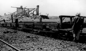 T. E. Lawrence surveys the results of a train-wrecking mission.