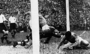 Enrique Guaita scores Italy's controversial winner against Austria in the semi-final in 1934.