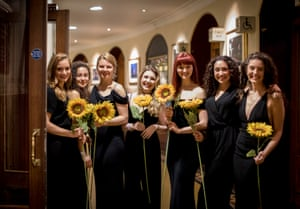 Some of the 200 members of the Women's Institute who appeared bearing flowers during a performance of The Girls