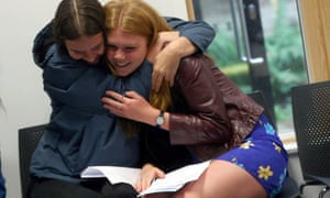Two girls embrace as they receive their 'A' level results at Stoke Newington School and Sixth Form in London