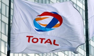 A Total flag at La Defense business and financial district in Paris