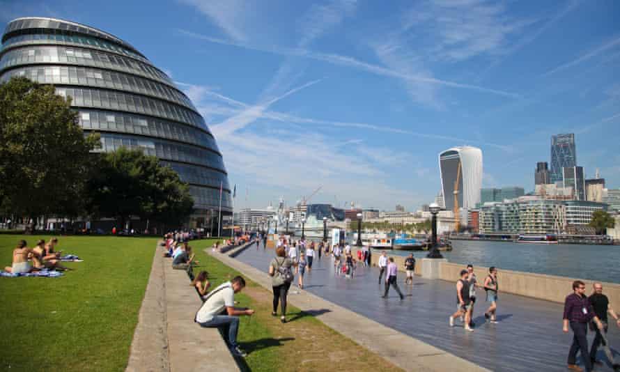People enjoying the sunshine near City Hall in London yesterday.