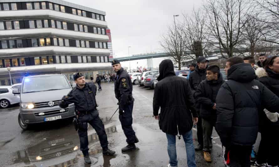 Police confront youths in Gothenburg in December 2012 amid protests over the 'Sluts of Gothenburg' Instagram account.