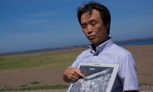 Kaoru Hasuike points at a map showing where he and his then girlfriend, Yukiko Okudo, were abducted by North Korean agents in 1978.