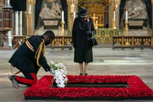 The Queen's Equerry, Lieutenant Colonel Nana Kofi Twumasi-Ankrah, places a bouquet of flowers at the grave of the Unknown Warrior on behalf of Queen Elizabeth II  during a ceremony in Westminster Abbey.