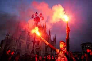 Inter Milan fans celebrate the football championship in Duomo square