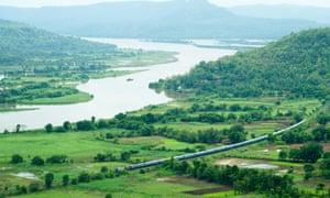 Konkan railway passing through paddy fields.