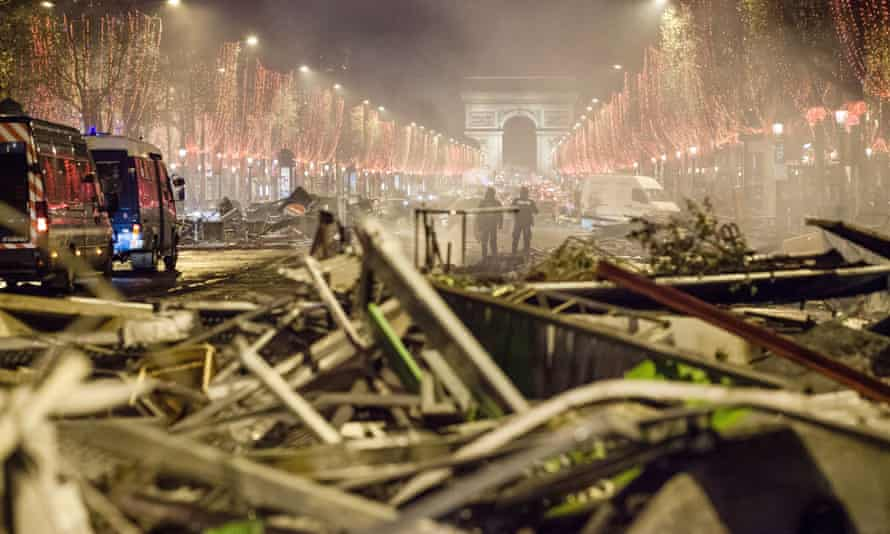 Cleaning crews clear the debris and barricades on the Champs-Élysées after the protests.