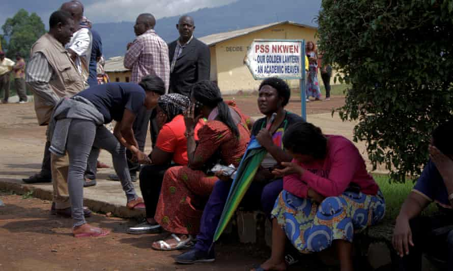 Parents await news of their children outside a Presbyterian boarding school.