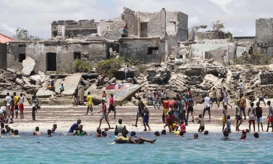 People swim in the water by Lido beach in Mogadishu