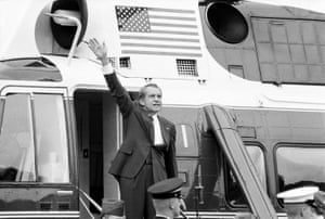 Richard Nixon waves goodbye from the steps of his helicopter outside the White House, after he gave a farewell address to members of the White House staff, in August 1974.