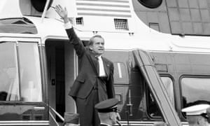 Richard Nixon waves goodbye from the steps of the presidential helicopter after a farewell address to White House staff on 7 August 1974