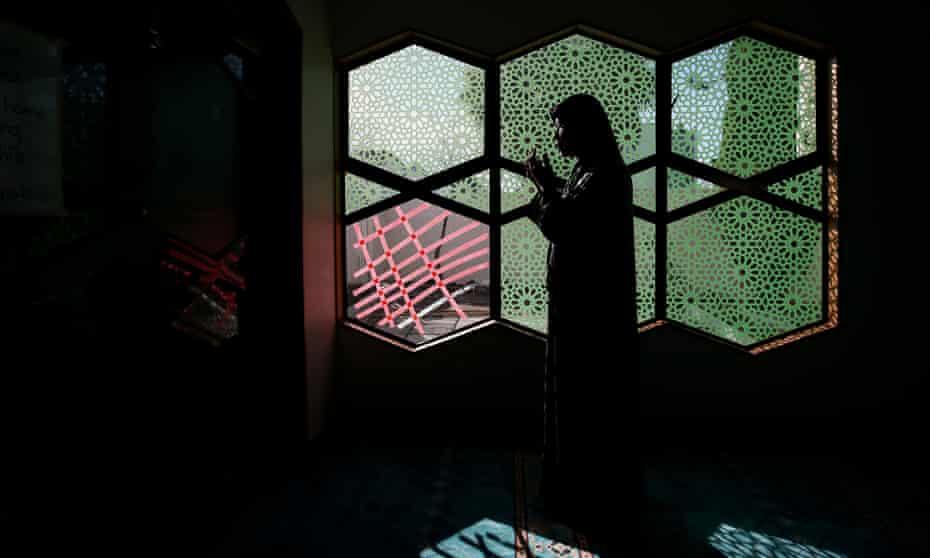 A survivor of the Christchurch terror attacks prays at the Al Noor Mosque
