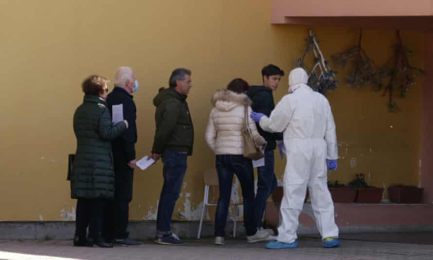 Volunteers line up to undergo testing in Vò, Italy, where the country's first coronavirus death occurred.