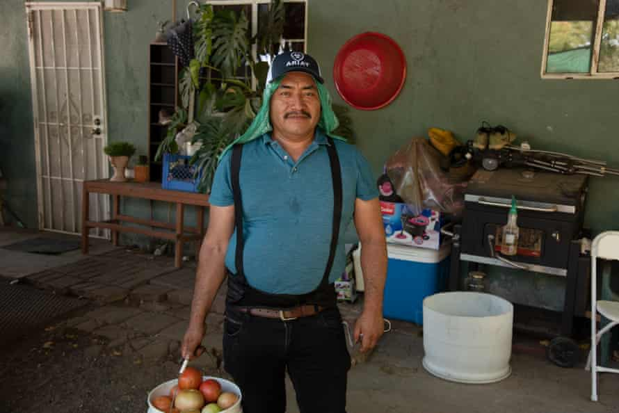 Jesús Zuñiga, a tomato picker, says that working long hours has become unbearable due to the heat.