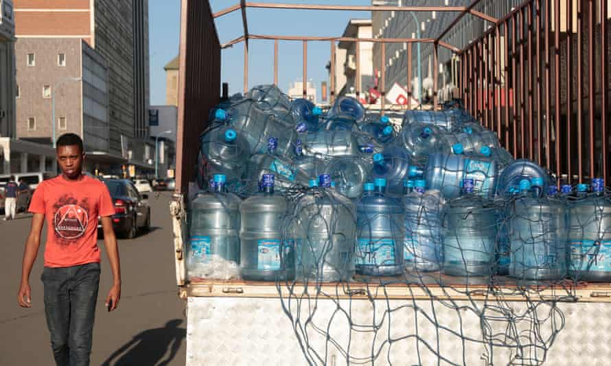 A truck carrying bottled water in Harare, Zimbabwe