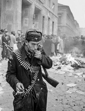 A rebel fighter with rifle ammunition draped across his body