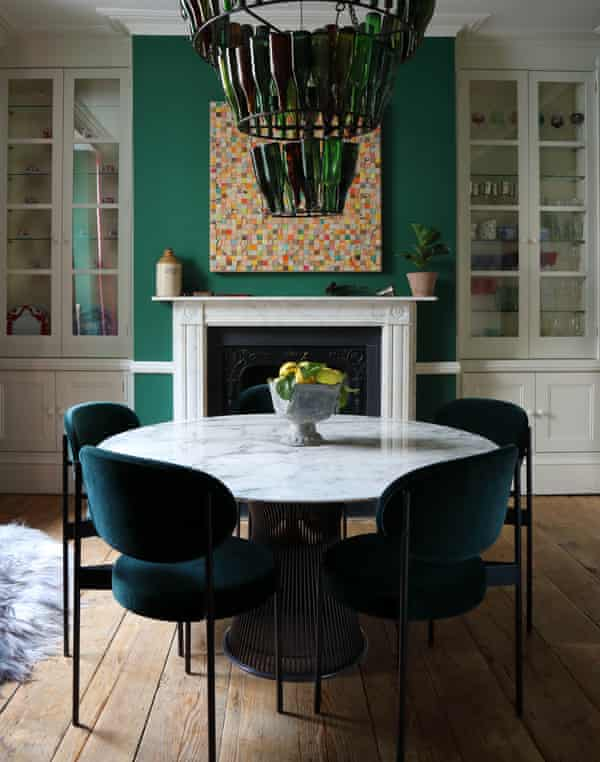 The dining room with recycled bottle chandelier.