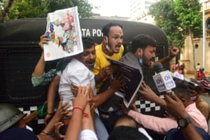 Police arrest youth congress members outside Raj Bhavan, the official residence of the governor of Bengal.