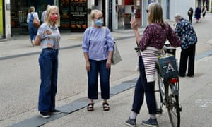 Masked shoppers on a street in Oxford