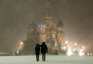 People walk through snow in Red Square, Moscow