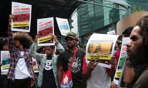 West Papuan activists at a rally calling for the nationalisation of the Indonesian unit of a US-based mining compan, and the right to self-determination for West Papua.