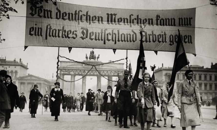 1931: National socialist demonstration in Berlin. The banner reads 'Only a strong Germany can provide employment to its people'.
