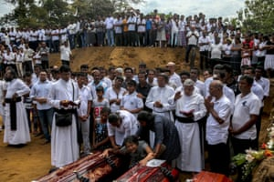 A mass burial of victims at a cemetery near St Sebastian's church in Negombo
