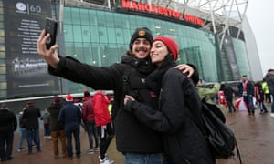 Couple taking selfie outside of Old Trafford