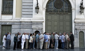 Pensioners queue outside a bank in Athens
