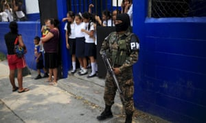 A member of a combined army-police unit secures a school in Soyapango before their deployment to deal with gang violence El Salvador last month.