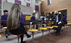 Boris Johnson meeting pupils in the canteen during a visit to Accrington academy in Lancashire.