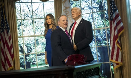 Sean Spicer in front of waxworks of Melania and Donald Trump at Madame Tussauds