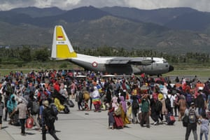 Residents queue to board a Hercules aircraft, as they are being evacuated after the earthquake and tsunami that hit the city, at Mutiara airport SIS Al-Jufrie, Palu.