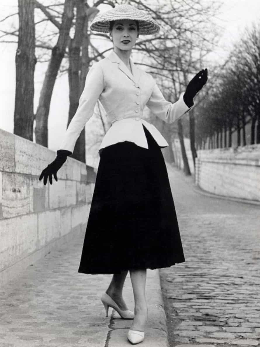 A model wears a suit by Christian Dior.
