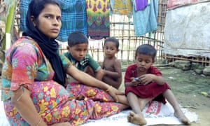 Sayeda Khatun with two of her four children and another child (centre).