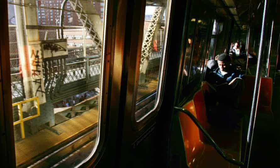 Man sits on New York subway