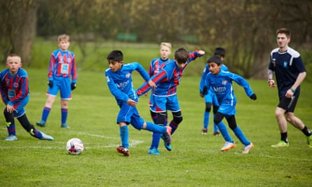 Abu Hanifah Foundation, in the blue shirts, launch an attack against Fulledge during their game at Witton Park, Blackburn