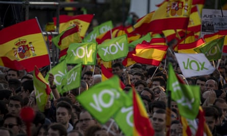 Supporters of far-right party Vox wave Spanish and Vox flags in the air in Madrid, Spain.