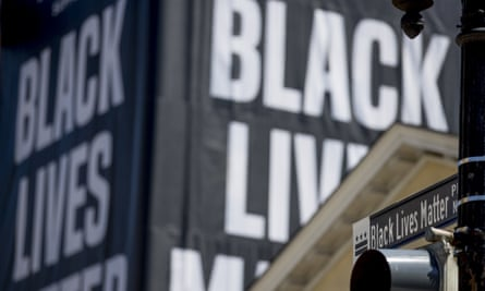 A banner reads Black lives matter in Washington DC.