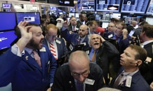 Traders on the floor of the New York Stock Exchange after the news of Donald Trump's victory spread.