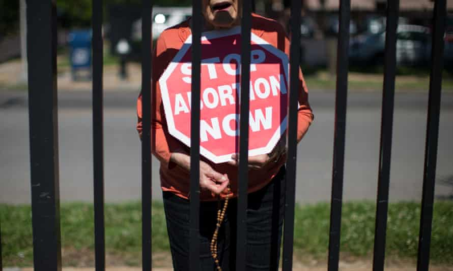 An abortion opponent protests outside Planned Parenthood in St Louis.
