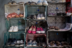 Rows of shoes are neatly stacked at Dohuk camp in Iraq